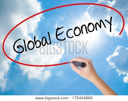 Woman Hand Writing Global Economy With Black Marker On Visual Screen