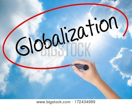 Woman Hand Writing Globalization With Black Marker On Visual Screen.