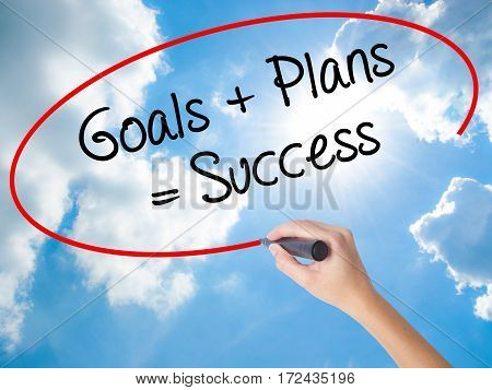 Woman Hand Writing Goals + Plans = Success With Black Marker On Visual Screen.