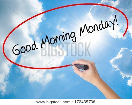 Woman Hand Writing Good Morning Monday! With Black Marker On Visual Screen