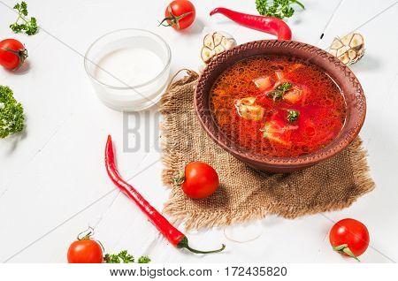 Traditional Ukrainian Russian vegetable borscht soup on light background.