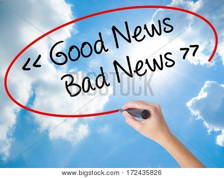 Woman Hand Writing Good News - Bad News With Black Marker On Visual Screen.