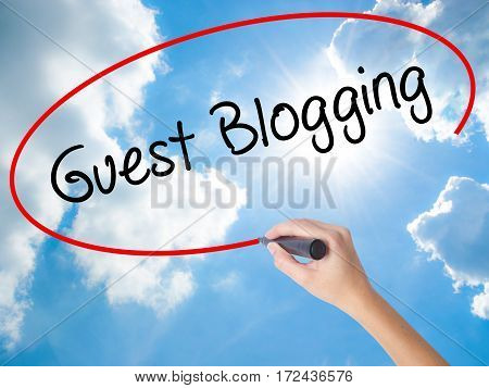Woman Hand Writing Guest Blogging  With Black Marker On Visual Screen