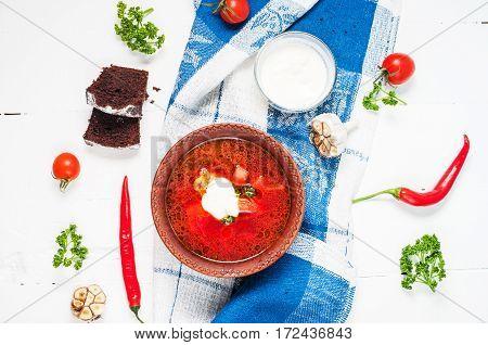 Traditional Ukrainian Russian vegetable borscht soup on light background. Top view