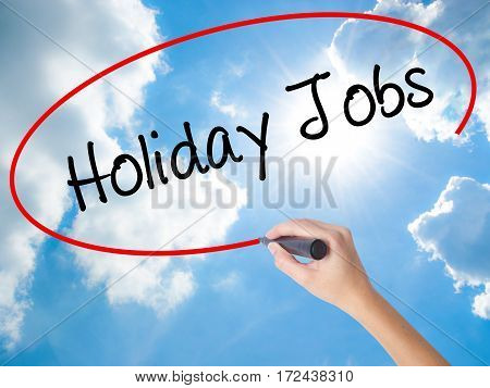 Woman Hand Writing Holiday Jobs  With Black Marker On Visual Screen