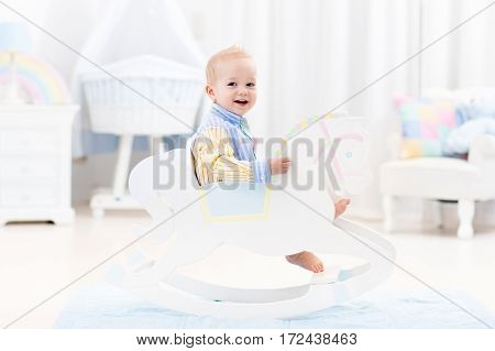 Baby Boy In Rocking Horse Toy