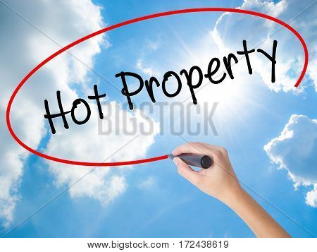 Woman Hand Writing Hot Property With Black Marker On Visual Screen