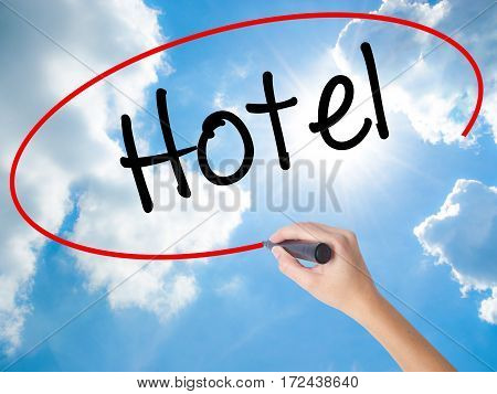 Woman Hand Writing Hotel With Black Marker On Visual Screen