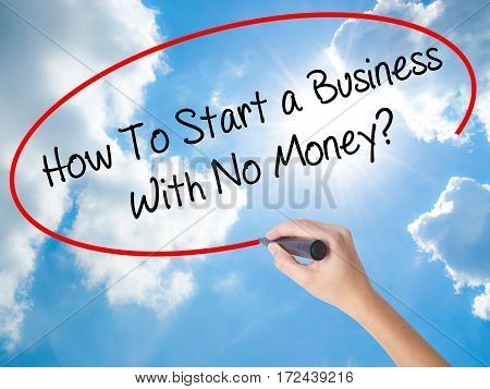 Woman Hand Writing How To Start A Business With No Money? With Black Marker On Visual Screen