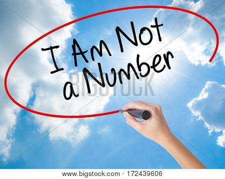 Woman Hand Writing I Am Not A Number With Black Marker On Visual Screen