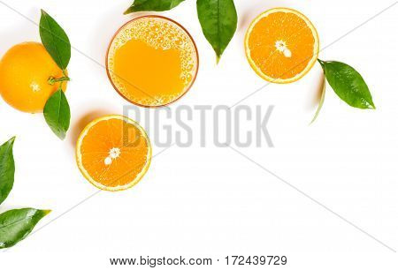 Top view of freshly squeezed orange juice with orange fruits with green leaves isolated on white background.