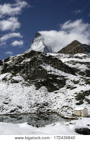 view of the matterhorn with a small alpin lake