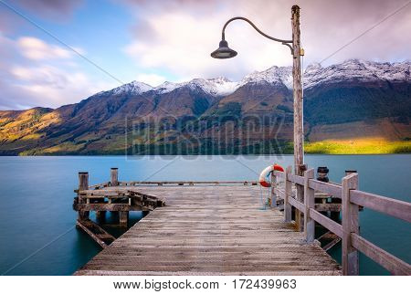 Glenorchy Wharf Wooden Pier And Lamp After Sunrise