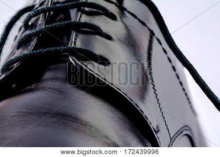 Macro shot: Shoelaces of a chic shoe.