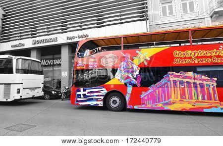MONASTIRAKI ATHENS GREECE, FEBRUARY 18 2017: red double decker bus with tourists for sightseeing tour Monastiraki Athens Greece. Editorial use.