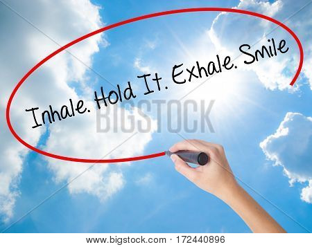 Woman Hand Writing Inhale Hold It Exhale Smile With Black Marker On Visual Screen