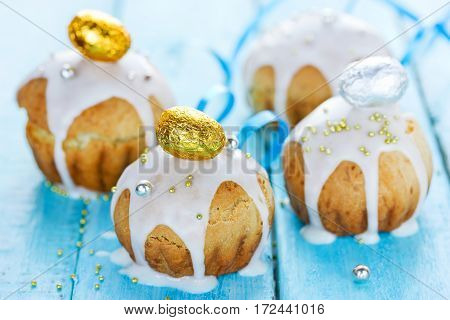 Traditional Easter cakes decorated with icing and golden candy eggs