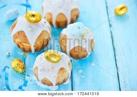 Easter cakes on blue background beautiful Easter baking food composition with copyspace