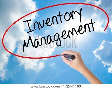 Woman Hand Writing Inventory Management With Black Marker On Visual Screen.