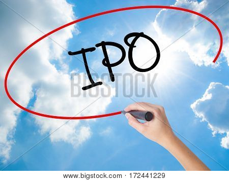 Woman Hand Writing Ipo (initial Public Offering)   With Black Marker On Visual Screen