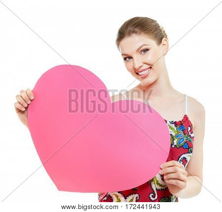 Portrait of attractive caucasian smiling woman holding big pink heart blank for love message for Valentine's  day, isolated on white studio shot.