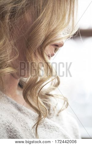 strand of blond wavy woman hair