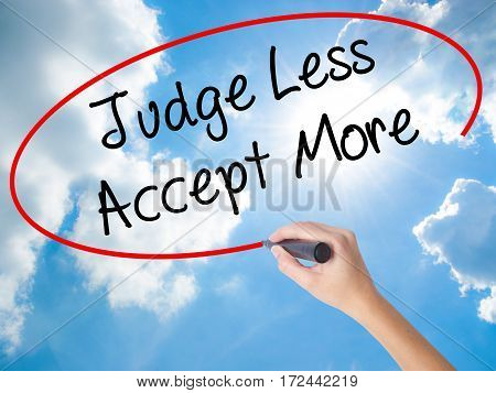 Woman Hand Writing Judge Less Accept More With Black Marker On Visual Screen