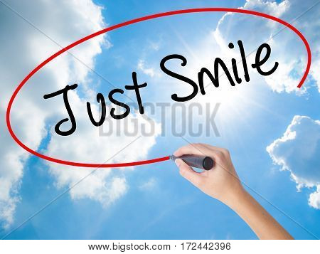 Woman Hand Writing Just Smile With Black Marker On Visual Screen