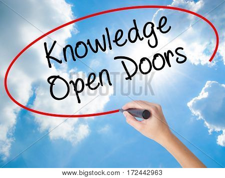 Woman Hand Writing  Knowledge Open Doors  With Black Marker On Visual Screen