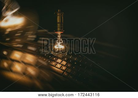 Light bulb and computer keyboard concept of wisdom.