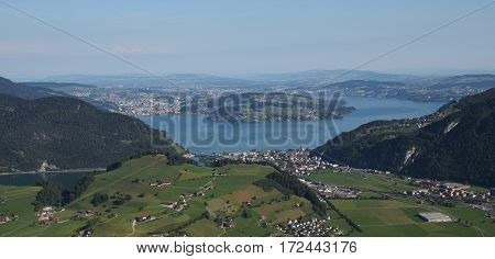 Lake Vierwaldstattersee Lucerne and green farmland. View from mount Stanserhorn.