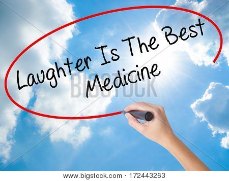 Woman Hand Writing Laughter Is The Best Medicine  With Black Marker On Visual Screen