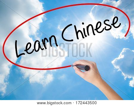 Woman Hand Writing Learn Chinese With Black Marker On Visual Screen.