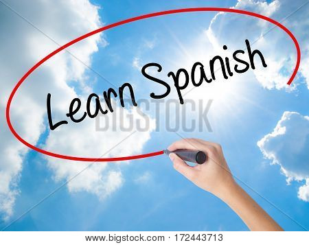 Woman Hand Writing Learn Spanish With Black Marker On Visual Screen