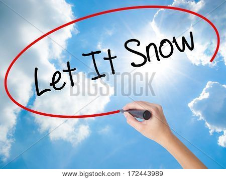 Woman Hand Writing Let It Snow With Black Marker On Visual Screen