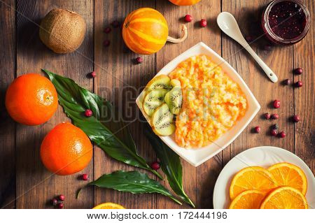 Pumpkin Porridge With Fruit. Autumn Still-life. A Rustic Style. Wooden Background. Top View. Close-u