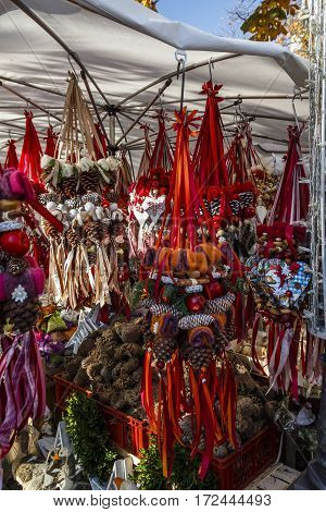 Sales stall offering decorated fire cones at the Viktualienmarkt in Munich