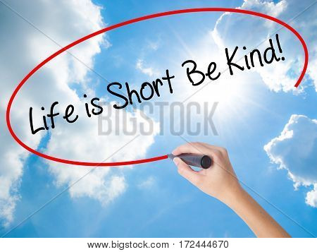 Woman Hand Writing Life Is Short Be Kind! With Black Marker On Visual Screen