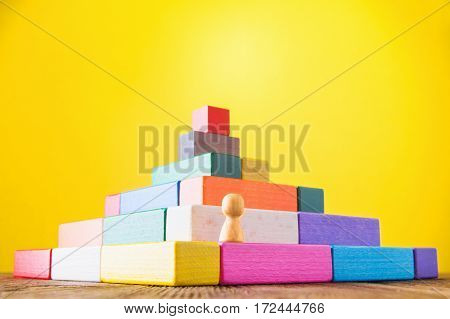 Business metaphor. Concept of business learning success. Man climbs the stairs of the pyramid. Achieving success. Career social status. Business competition. The concept of unequal competition.