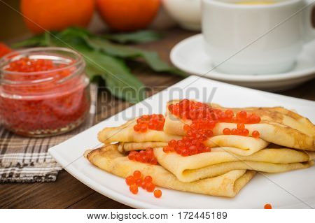 Pancakes With Red Caviar. Russian Cuisine. Flat Lay. Maslenitsa. Wooden Background. Close-up