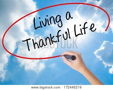 Woman Hand Writing Living A Thankful Life With Black Marker On Visual Screen