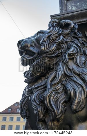 MUNICH, GERMANY - OCTOBER 31, 2015: Lion of the Max Joseph monument in front of the New Residence Theatre at Odeonsplatz in Munich