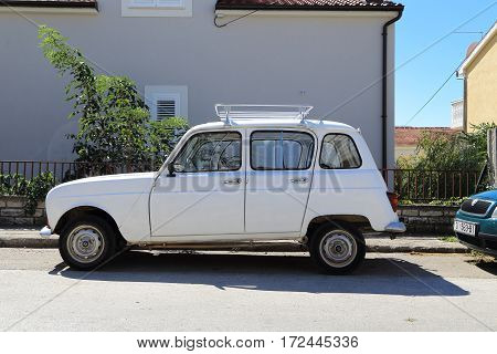 VODIVE, CROATIA - SEPTEMBER 6, 2016: It is an urban compact car Renault 4 on a city street of the coastal Dalmatian town.