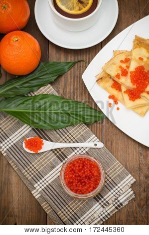 Pancakes With Red Caviar. Russian Cuisine. Flat Lay. Maslenitsa. Wooden Background. Top View. Close-