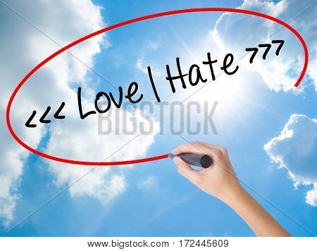 Woman Hand Writing Love - Hate  With Black Marker On Visual Screen