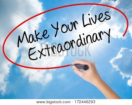 Woman Hand Writing Make Your Lives Extraordinary With Black Marker On Visual Screen