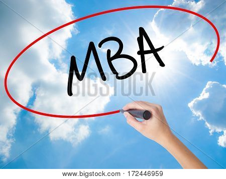 Woman Hand Writing Mba With Black Marker On Visual Screen