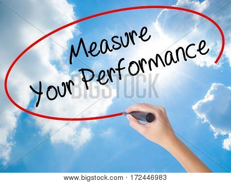Woman Hand Writing Measure Your Performance With Black Marker On Visual Screen
