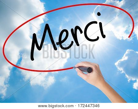 Woman Hand Writing Merci  (thank You In French) With Black Marker On Visual Screen.