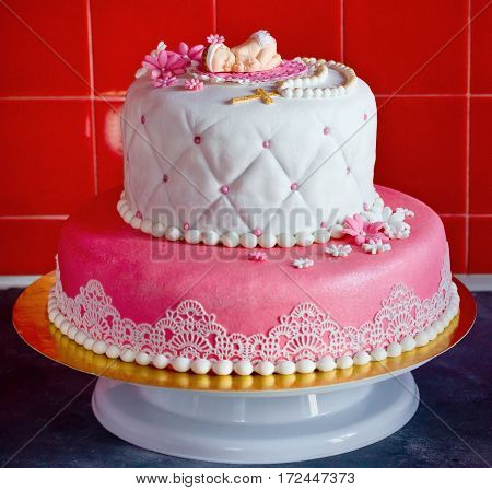 Christening cake for baby girl on stand